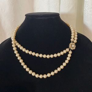 LN double strand of Faux pearls.